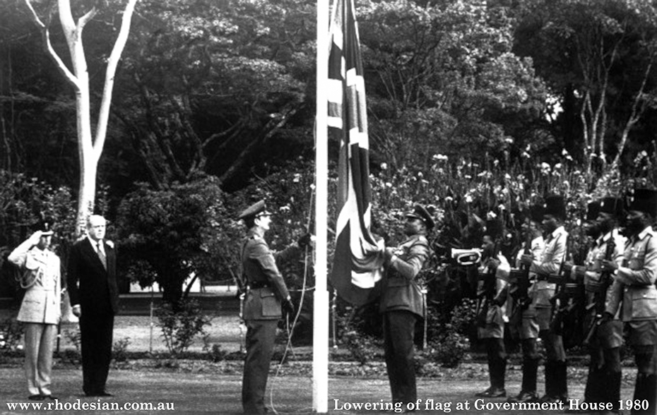 Photograph of lowering of the Union Jack flag at Government House in Harare with Prince Charles and Lord Soames on April 1980
