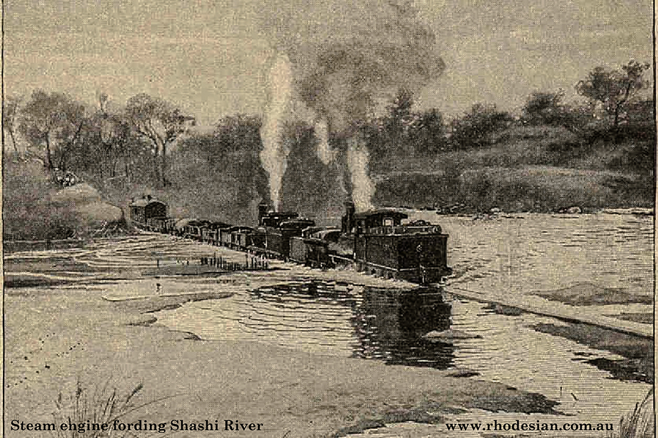 Photo of train fording Shashi River with water over the bridge